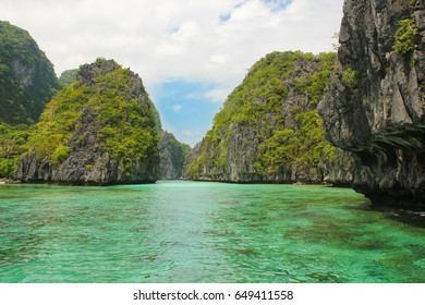 Magnificent karst mountains landscape on crystalline  turquoise water in Bacuit Bay near El Nido, Palawan, Philippines