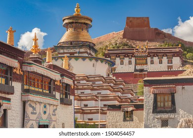Magnificent Kumbum Stupa in Gyantse with fortress in background