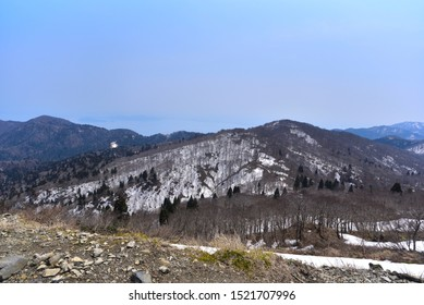 Magnificent landscape with remaining snow. It is the magnificent landscape during hiking. There is some remaining snow so it is difficult to walk, but we can see greatest view from the summit.
