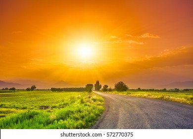 magnificent landscape of road on meadow on background of beautiful sunset sky with clouds. Exploring Armenia