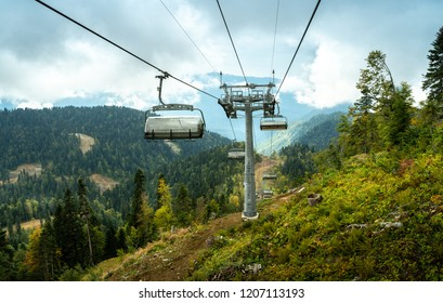 Magnificent landscapes of Sochi on the open cable car to the top of the mountain Rose Peak with views of the forest and the mountains and the sky.