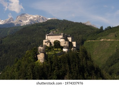 The magnificent medieval Hohenwerfen Castle is sitting on a rock and shines in the sunlight