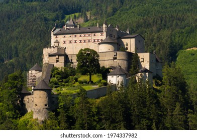 The magnificent medieval Hohenwerfen Castle sitting on a rock shines in the sunlight