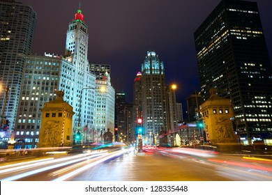 Magnificent Mile with traffic at night, Chicago, IL, USA
