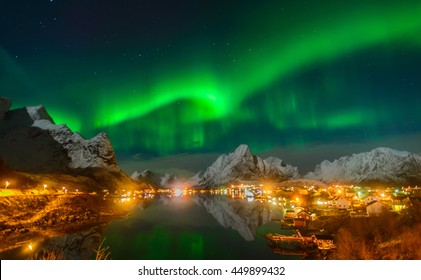 Magnificent Nothern Lights over the Village of Reine, Lofoten Islands, Norway.