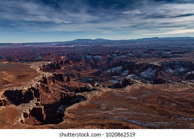 Magnificent Panoramic view of Canyonlands National Park in the winter with snow and cloudscape in Moab Utah USA.