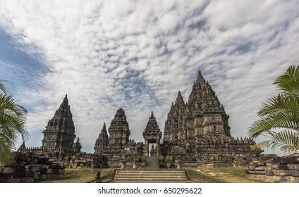 Magnificent PRAMBANAN TEMPLE wide view with beautiful cloudy blue sky background in afternoon