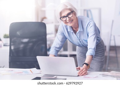 Magnificent retirement worker smiling on camera