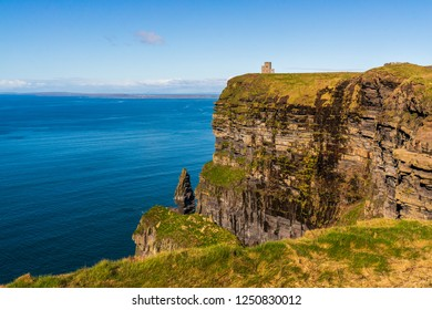 Magnificent rugged cliffs facing the mighty ocean landscape. Cliffs of Moher, Ireland's most spectacular natural wonder at the heart of the Wild Atlantic Way, County Clare.