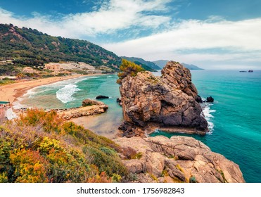 Magnificent spring view of Pelekas beach. Splendid morning seascape of Ionian Sea. Wonderful landscape of Corfu island, Kontogialos health resort, Greece, Europe. Traveling concept background.