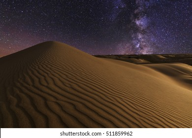 Magnificent starry sky over the desert landscape