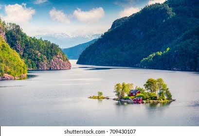 Magnificent summer view with small island with typical Norwegian building on Lovrafjorden fjord, North sea. Colorful morning view in Norway. Beauty of nature concept background.