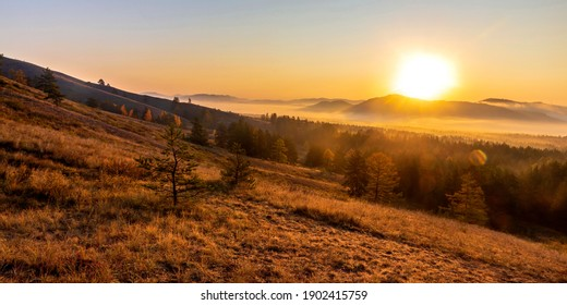 Magnificent sunrise over Mount Eseikey in the Ural Mountains, the beginning of an autumn day.