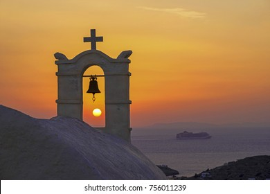 Magnificent sunset from the old white orthodox church overlooking the Aegean sea,  in  Cyclades islands, Greece