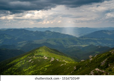 Magnificent top of rocky Mountain, green background