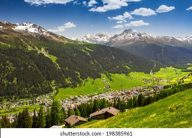 Magnificent valley with Davos city surrounded by Jakobshorn and Rinerhorn  Swiss Alps peaks from the top of the Schatzalp mountain, Grisons, Switzerland