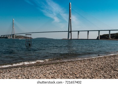Magnificent view of the cable-stayed bridge from the mainland to the island across the strait, beautiful sea background