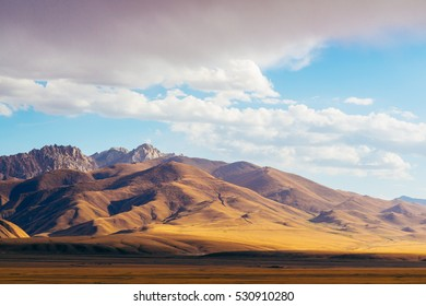 The magnificent view of colourful Tien Shan (Tian Shan) mountain  landscape in the east of Kyrgyzstan, on the way to Chinese Border of Xinjiang province. Central Asia