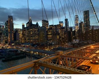 A magnificent view of the financial district of NYC from the Brooklyn Bridge.