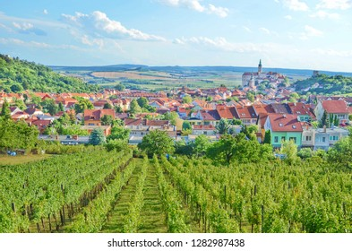 Magnificent view of green vineyards located on the hill close to beautiful historical city Mikulov in Czech Republic. The dominant of this beautiful town is Mikulov Castle.