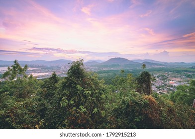 Magnificent view on Phuket mountains covered with exotic plantlife surrounded by ocean. Phuket, Thailand.