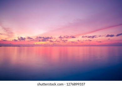 Magnificent view of sea sunset, bright horizon. Inspirational beautiful beach and sea view, reflection. Colorful evening seascape - skyscape. Zen nature concept, calmness, relaxation