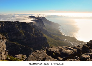 Magnificent view of Table Mountain top covered in clouds in sunset