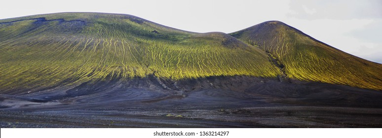 Magnificent volcanic scenery on the road to Landmannalaugar, Iceland. Black volcanic ash covered by green mosses.