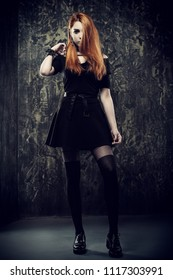 Magnificent woman in black gothic dress over grunge background. Fashion. Gothic style.