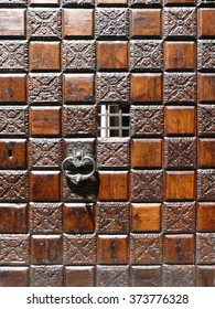Magnificent wooden door at the Golden House in Venice, Italy