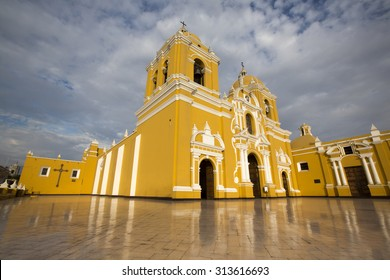 Magnificent yellow cathedral with a beautiful blue sky and light reflections in Trujillo, Peru
