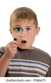 Magnified eye on child through magnifying glass