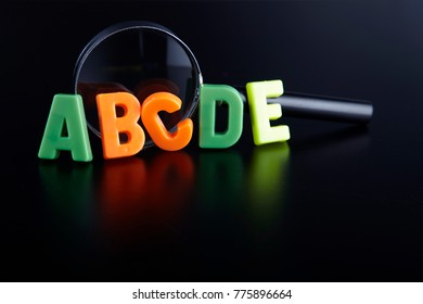 magnifier glass and alphabet abc