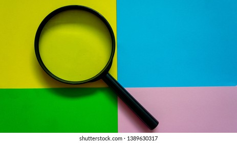 magnifier glass on colorful and abstract background