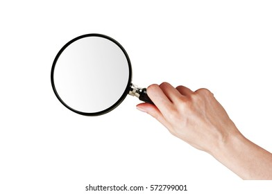 Magnifier glass in woman hand isolated on white background