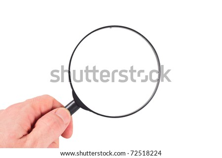 a magnifier in a hand on white