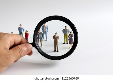 Magnifier and miniature people.