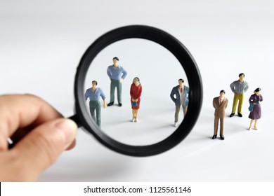 Magnifier and miniature people. Concept of female worker recruitment.
