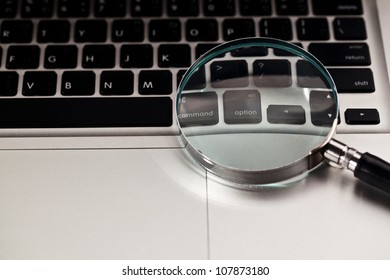Magnifier on computer notebook , Concept of searching