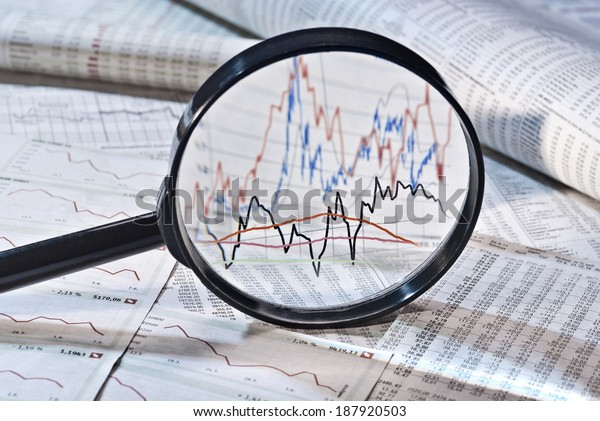 Magnifier shows the variation of stock prices,
