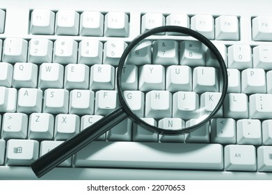 Magnifying glass, button, key