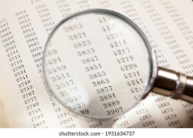 magnifying glass and document with figures, data encrypt with magnifying glass. Cipher encryption code or data
