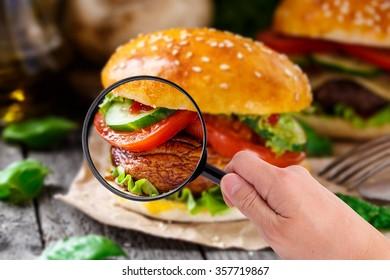 Magnifying glass examining burger