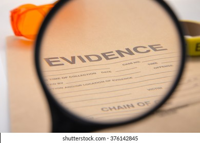 magnifying glass focus on evidence bag for detective and law enforcement