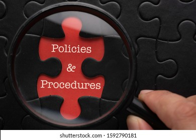 Magnifying glass focus on puzzle written Policies and Procedures. Simple business concept,