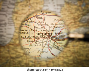 Magnifying Glass in front of a Detroit map