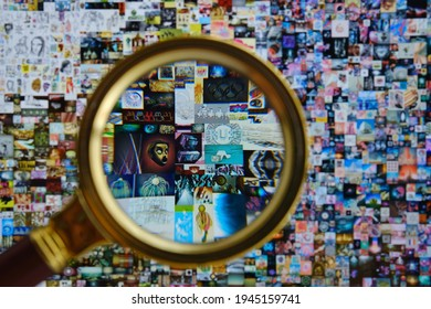 Magnifying glass in front of ipad screen with Beeple digital art EVERYDAYS: THE FIRST 5000 DAYS. Collage art signed with non fungible token. Concept. Stafford, United Kingdom, March 28, 2021.