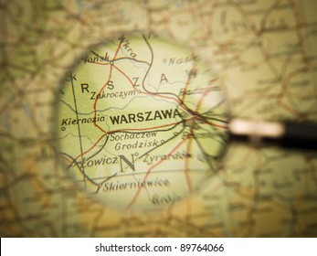 Magnifying Glass in front of a Warzawa map