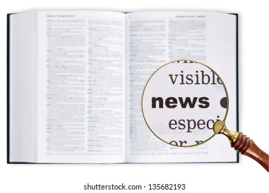 A magnifying glass held over a dictionary looking at the word News enlarged