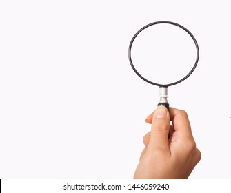 magnifying glass holding hand for research